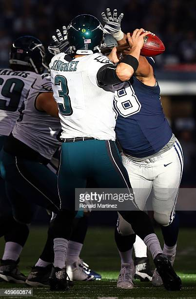 Mark Sanchez of the Philadelphia Eagles is hit by Tyrone Crawford of the Dallas Cowboys in the first half at AT&T Stadium on November 27, 2014 in...