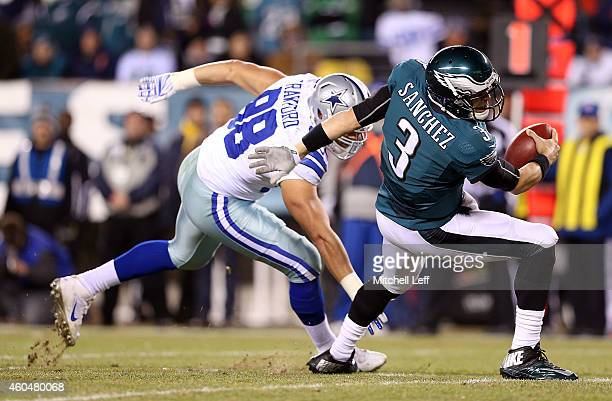 Mark Sanchez of the Philadelphia Eagles is sacked by Tyrone Crawford of the Dallas Cowboys at Lincoln Financial Field on December 14, 2014 in...