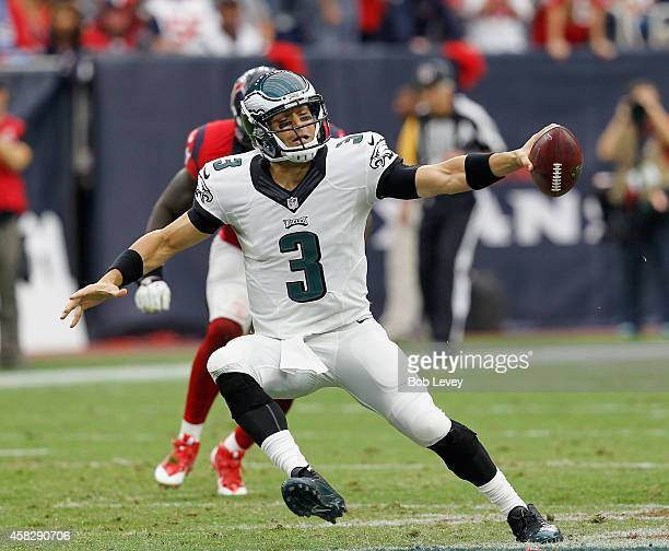 Mark Sanchez of the Philadelphia Eagles looks for a receiver in the second quarter against the Houston Texans at Reliant Stadium on November 2 2014...