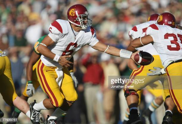 Mark Sanchez of the University of Southern California Trojans hands off the ball during the game against the Notre Dame Fighting Irish on October 20,...