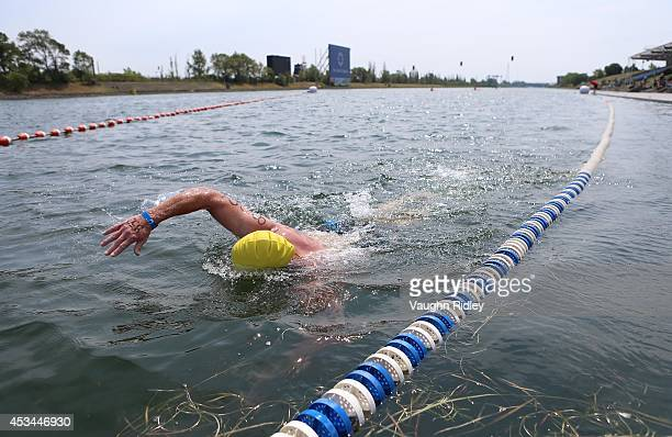 Mark Sandt of the US competes in the Men's 5054 Age Group 3km swim during the 15th FINA World Masters Championships at Parc JeanDrapeau on August 10...