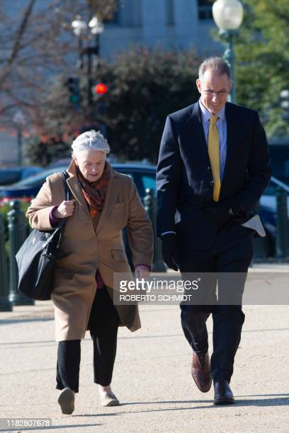 Mark Sandy a senior official at the Office of Management and Budget arrives to the US Capitol with attorney Barbara Van Gelder for a closed door...