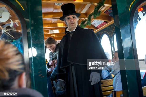 Mark Scalia depicting Ebenezer Scrooge looks on during the interactive performance of A Christmas Carol along the Salem Trolley in Salem MA on Nov 30...
