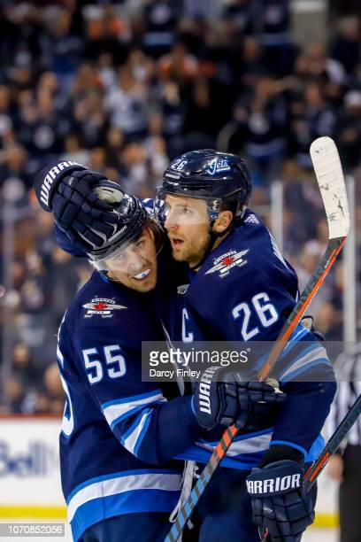 Mark Scheifele and Blake Wheeler of the Winnipeg Jets celebrate a second period goal against the Philadelphia Flyers at the Bell MTS Place on...