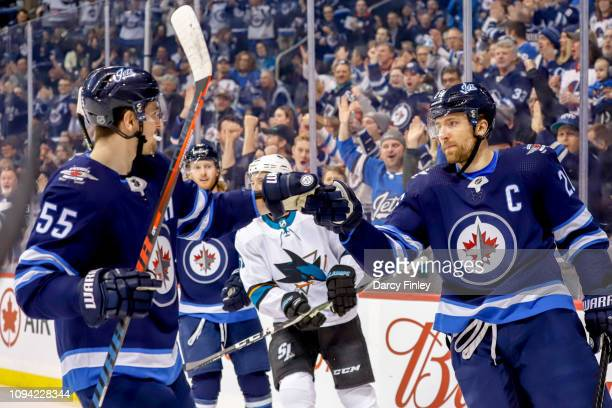Mark Scheifele and Blake Wheeler of the Winnipeg Jets celebrate a first period goal against the San Jose Sharks at the Bell MTS Place on February 5...
