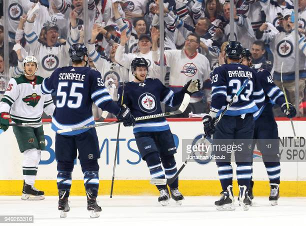 Mark Scheifele Andrew Copp Dustin Byfuglien and Joel Armia of the Winnipeg Jets celebrate a first period goal against the Minnesota Wild in Game Five...