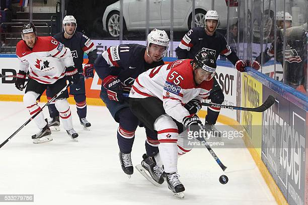 Mark Scheifele of Canada and Brock Nelson of USA battle for the puck at Ice Palace on May 21 2016 in Moscow Russia Canada defeated USA 43