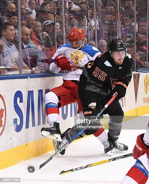 Mark Scheifele of Team North America collides with Dmitry Kulikov of Team Russia along the boards during the World Cup of Hockey 2016 at Air Canada...