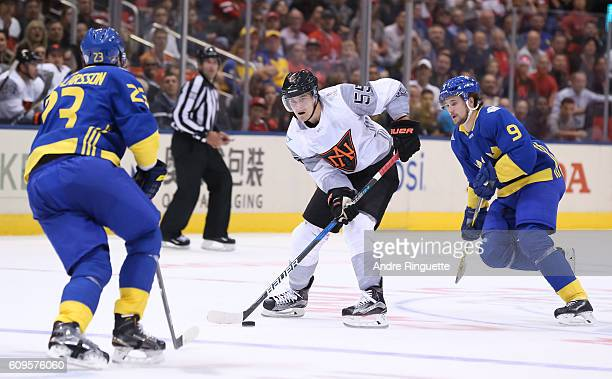 Mark Scheifele of Team North America stickhandles the puck with pressure from Oliver EkmanLarsson and Filip Forsberg of Team Sweden during the World...