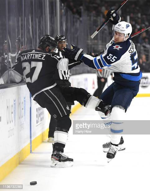 Mark Scheifele of the Winnipeg Jets and Alec Martinez of the Los Angeles Kings collide during the third period in a 32 Jets win at Staples Center on...