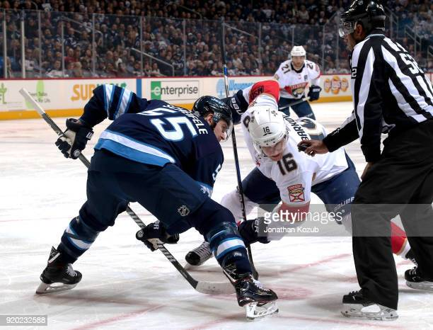 Mark Scheifele of the Winnipeg Jets and Aleksander Barkov of the Florida Panthers get set for a first period faceoff at the Bell MTS Place on...