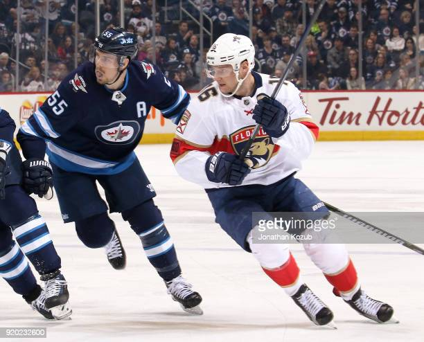 Mark Scheifele of the Winnipeg Jets and Aleksander Barkov of the Florida Panthers follow the play down the ice during first period action at the Bell...