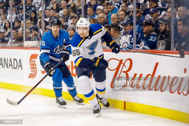 Mark Scheifele of the Winnipeg Jets and Colton Parayko of the St Louis Blues follow the play around the boards during first period action at the Bell...