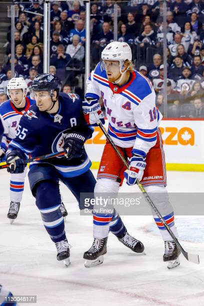 Mark Scheifele of the Winnipeg Jets and Marc Staal of the New York Rangers keep an eye on the play during third period action at the Bell MTS Place...