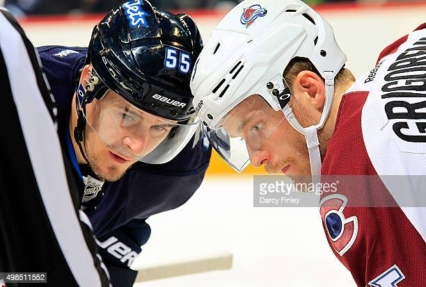 Mark Scheifele of the Winnipeg Jets and Mikhail Grigorenko of the Colorado Avalanche get set for a first period faceoff at the MTS Centre on November...