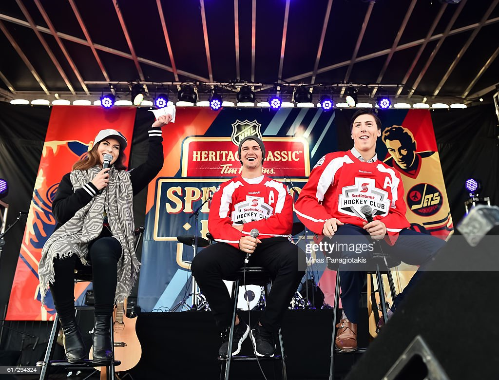 Mark Scheifele #55 of the Winnipeg Jets and Ryan Nugent-Hopkins #93 of the Edmonton Oilers are interviewed on stage in Spectator Plaza in advance of the 2016 Tim Hortons NHL Heritage Classic game at Investors Group Field on October 22, 2016 in Winnipeg, Canada.