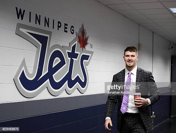Mark Scheifele of the Winnipeg Jets arrives at the arena sporting a lavender tie in support of Hockey Fights Cancer prior to NHL action against the...