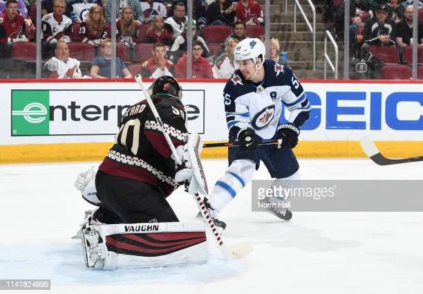 Mark Scheifele of the Winnipeg Jets attempts to score on Calvin Pickard of the Arizona Coyotes at Gila River Arena on April 6 2019 in Glendale Arizona
