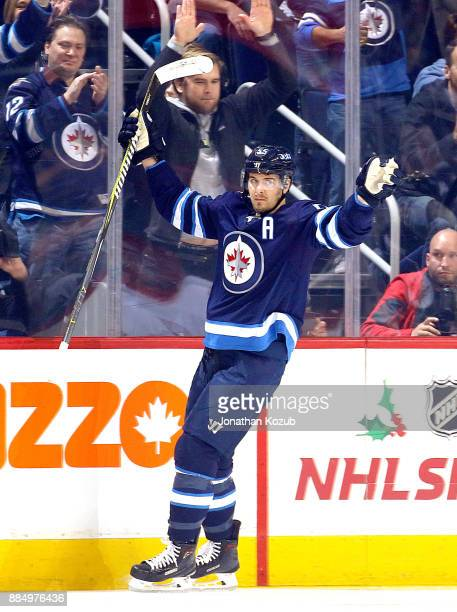 Mark Scheifele of the Winnipeg Jets celebrates after scoring a first period goal against the Ottawa Senators at the Bell MTS Place on December 3 2017...