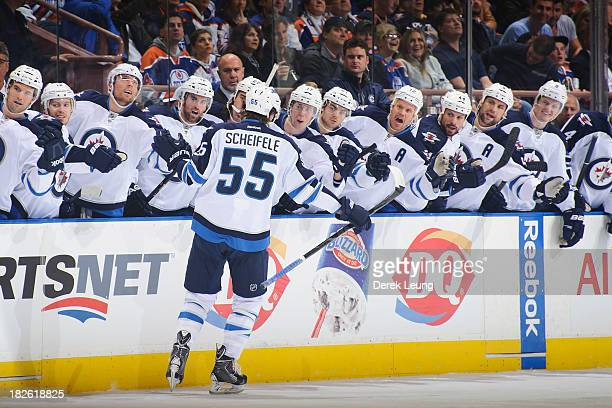 Mark Scheifele of the Winnipeg Jets celebrates after scoring the Jets' first goal against the Edmonton Oilers during an NHL game at Rexall Place on...