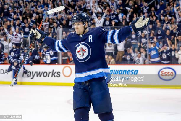 Mark Scheifele of the Winnipeg Jets celebrates after scoring the overtime winning goal against the Tampa Bay Lightning at the Bell MTS Place on...