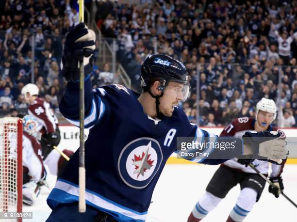 Mark Scheifele of the Winnipeg Jets celebrates after teammate Andrew Copp scores a second period goal against the Colorado Avalanche at the Bell MTS...