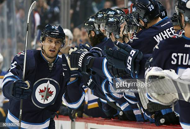 Mark Scheifele of the Winnipeg Jets celebrates his first period goal against the St Louis Blues with teammates at the bench at the MTS Centre on...