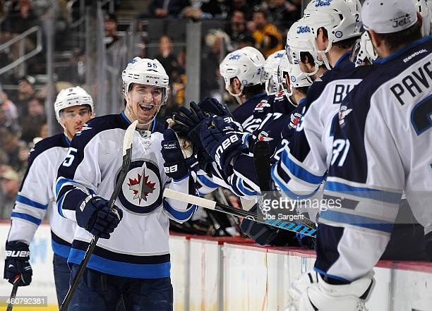 Mark Scheifele of the Winnipeg Jets celebrates his goal with the bench during the first period against the Pittsburgh Penguins on January 5 2014 at...