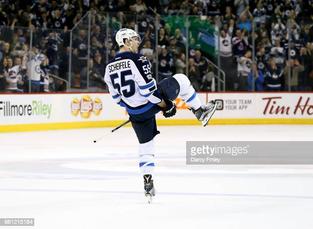 Mark Scheifele of the Winnipeg Jets celebrates his overtime winning goal against the Anaheim Ducks at the MTS Centre on March 30 2017 in Winnipeg...