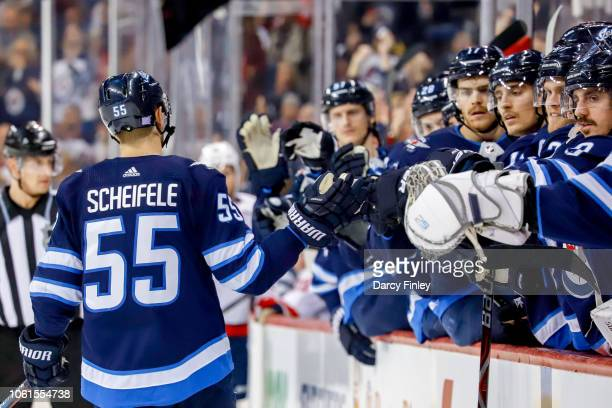 Mark Scheifele of the Winnipeg Jets celebrates his second period goal against the Washington Capitals with teammates at the bench at the Bell MTS...
