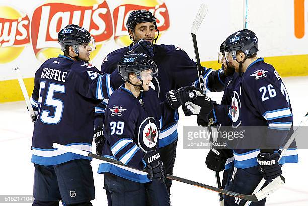 Mark Scheifele of the Winnipeg Jets celebrates his second period goal against the Colorado Avalanche with teammates Toby Enstrom Dustin Byfuglien...