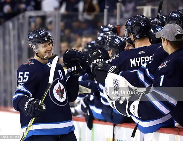 Mark Scheifele of the Winnipeg Jets celebrates his third period goal against the Vegas Golden Knights with teammates at the bench at the Bell MTS...