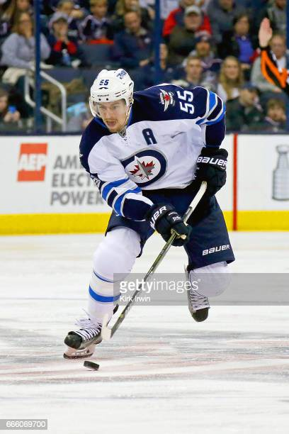 Mark Scheifele of the Winnipeg Jets controls the puck during the game against the Columbus Blue Jackets on April 6 2017 at Nationwide Arena in...