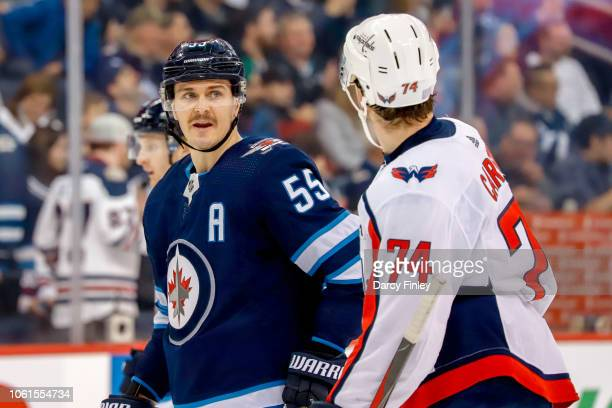 Mark Scheifele of the Winnipeg Jets exchanges words with John Carlson of the Washington Capitals during a second period stoppage in play at the Bell...