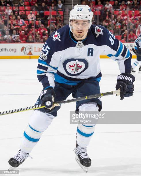 Mark Scheifele of the Winnipeg Jets follows the play against the Detroit Red Wings during an NHL game at Little Caesars Arena on December 5 2017 in...