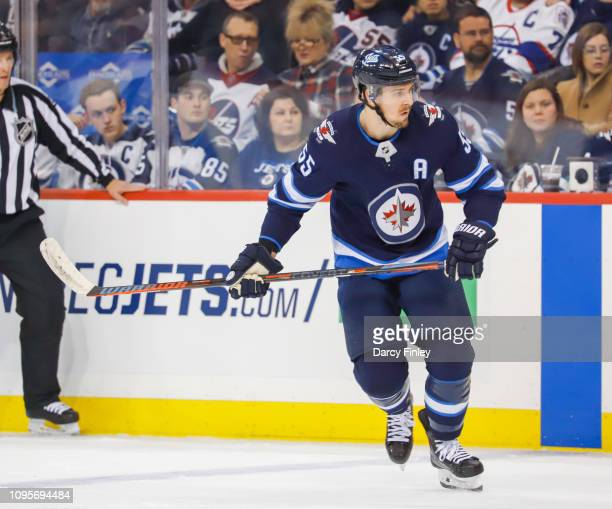 Mark Scheifele of the Winnipeg Jets follows the play down the ice during first period action against the Anaheim Ducks at the Bell MTS Place on...