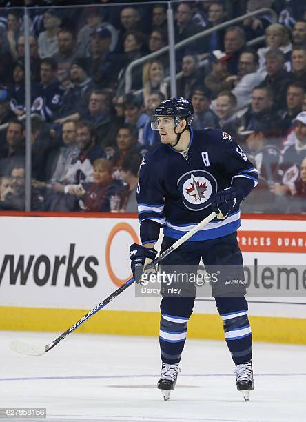 Mark Scheifele of the Winnipeg Jets follows the play down the ice during third period action against the New Jersey Devils at the MTS Centre on...