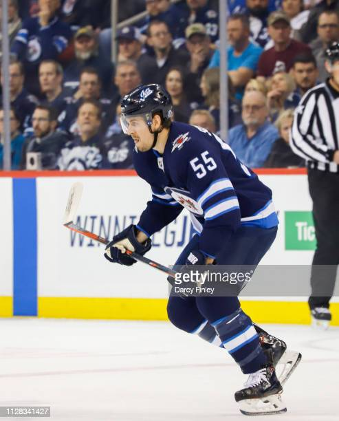 Mark Scheifele of the Winnipeg Jets follows the play up the ice during first period action against the San Jose Sharks at the Bell MTS Place on...