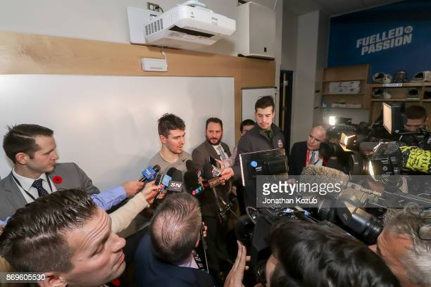 Mark Scheifele of the Winnipeg Jets gets interviewed by a throng of media following his hat trick performance in a 52 victory over the Dallas Stars...
