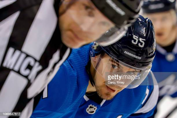 Mark Scheifele of the Winnipeg Jets gets set for a third period faceoff against the St Louis Blues at the Bell MTS Place on December 7 2018 in...
