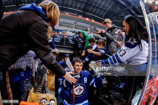 Mark Scheifele of the Winnipeg Jets heads to the ice for the start of the pregame warm up prior to NHL action against the San Jose Sharks at the Bell...