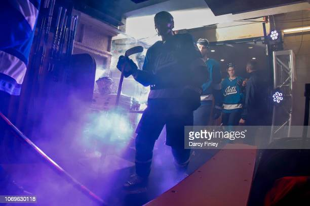 Mark Scheifele of the Winnipeg Jets heads to the ice prior to puck drop against the St Louis Blues at the Bell MTS Place on December 7 2018 in...