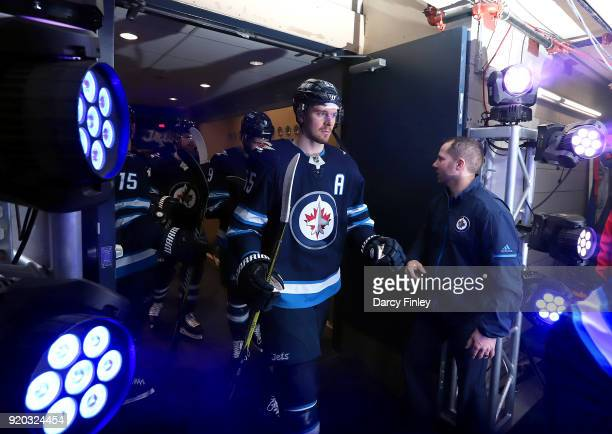 Mark Scheifele of the Winnipeg Jets heads to the ice prior to puck drop against the Florida Panthers at the Bell MTS Place on February 18 2018 in...