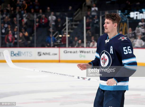 Mark Scheifele of the Winnipeg Jets hits the ice after receiving second star honours following a 61 victory over the Colorado Avalanche at the Bell...