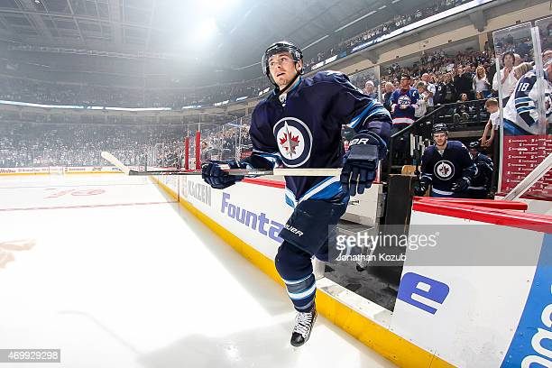 Mark Scheifele of the Winnipeg Jets hits the ice prior to puck drop against the Calgary Flames on April 11 2015 at the MTS Centre in Winnipeg...