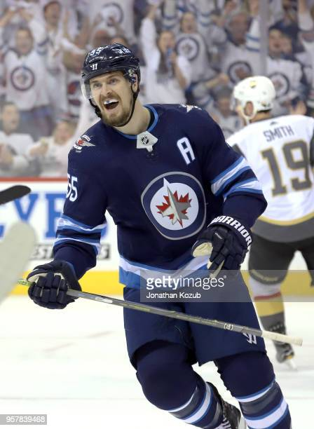 Mark Scheifele of the Winnipeg Jets is all smiles as he celebrates a first period goal by teammate Patrik Laine against the Vegas Golden Knights in...