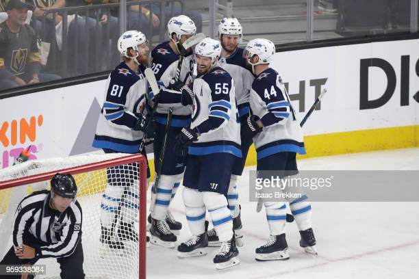 Mark Scheifele of the Winnipeg Jets is congratulated by his teammates after scoring a secondperiod goal against the Vegas Golden Knights in Game...