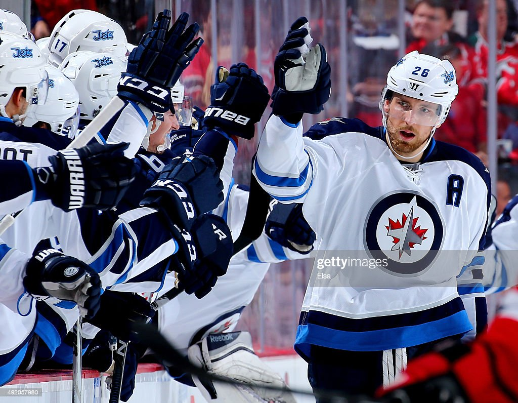 Mark Scheifele #55 of the Winnipeg Jets is congratulated by teammates on the bench after he scored a goal in the second period against the New Jersey Devils on October 9, 2015 at the Prudential Center in Newark, New Jersey.
