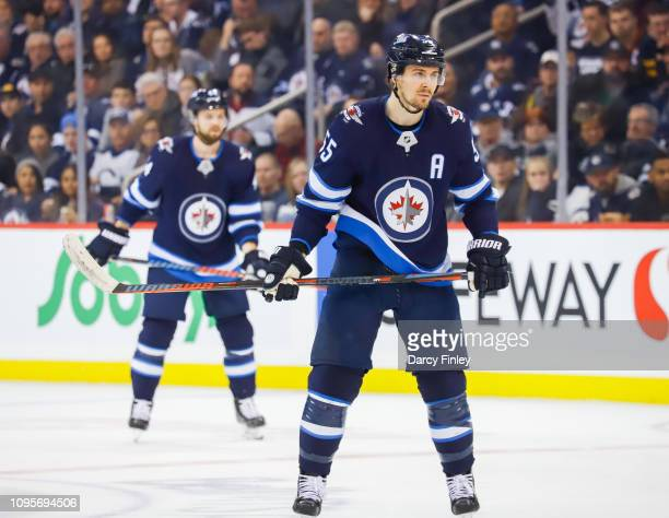 Mark Scheifele of the Winnipeg Jets keeps an eye on the play during first period action against the Anaheim Ducks at the Bell MTS Place on January 13...