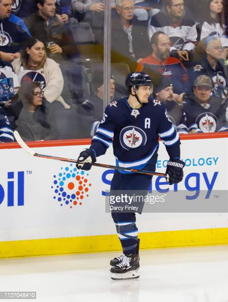 Mark Scheifele of the Winnipeg Jets keeps an eye on the play during second period action against the Columbus Blue Jackets at the Bell MTS Place on...
